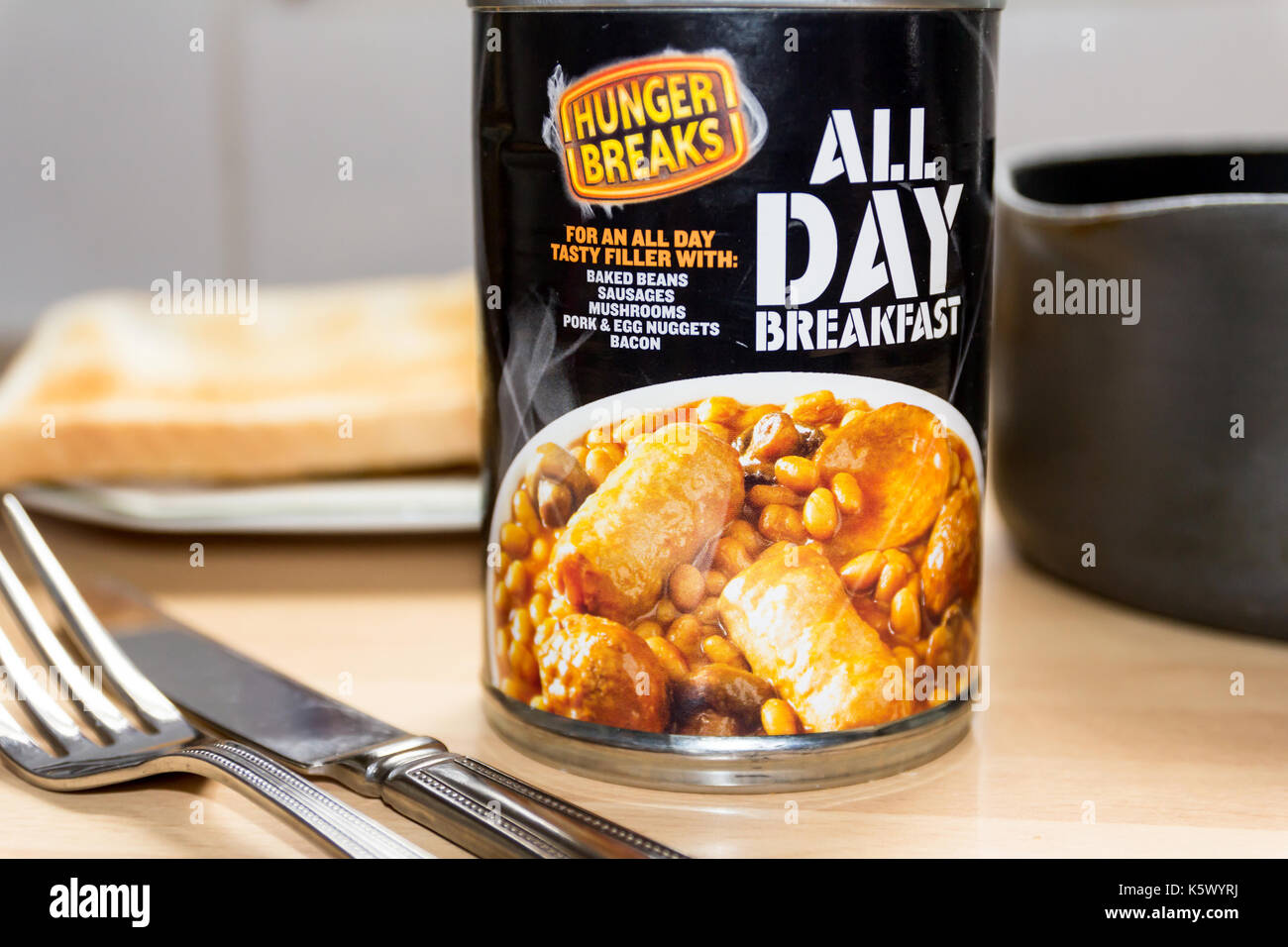 TELFORD, SHROPSHIRE U.K. - SEPTEMBER 6, 2017: Still Life of a can of 'All Day Breakfast' with toast in the background and a saucepan to the right. - Stock Image
