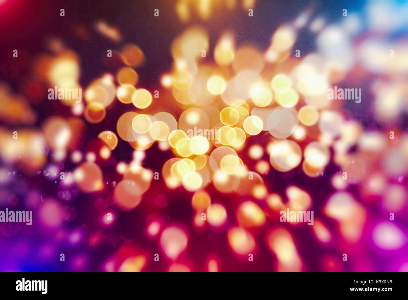 Festive background with natural bokeh and bright golden lights. Vintage Magic background with colorful bokeh. Spring Summer Christmas New Year disco p - Stock Image