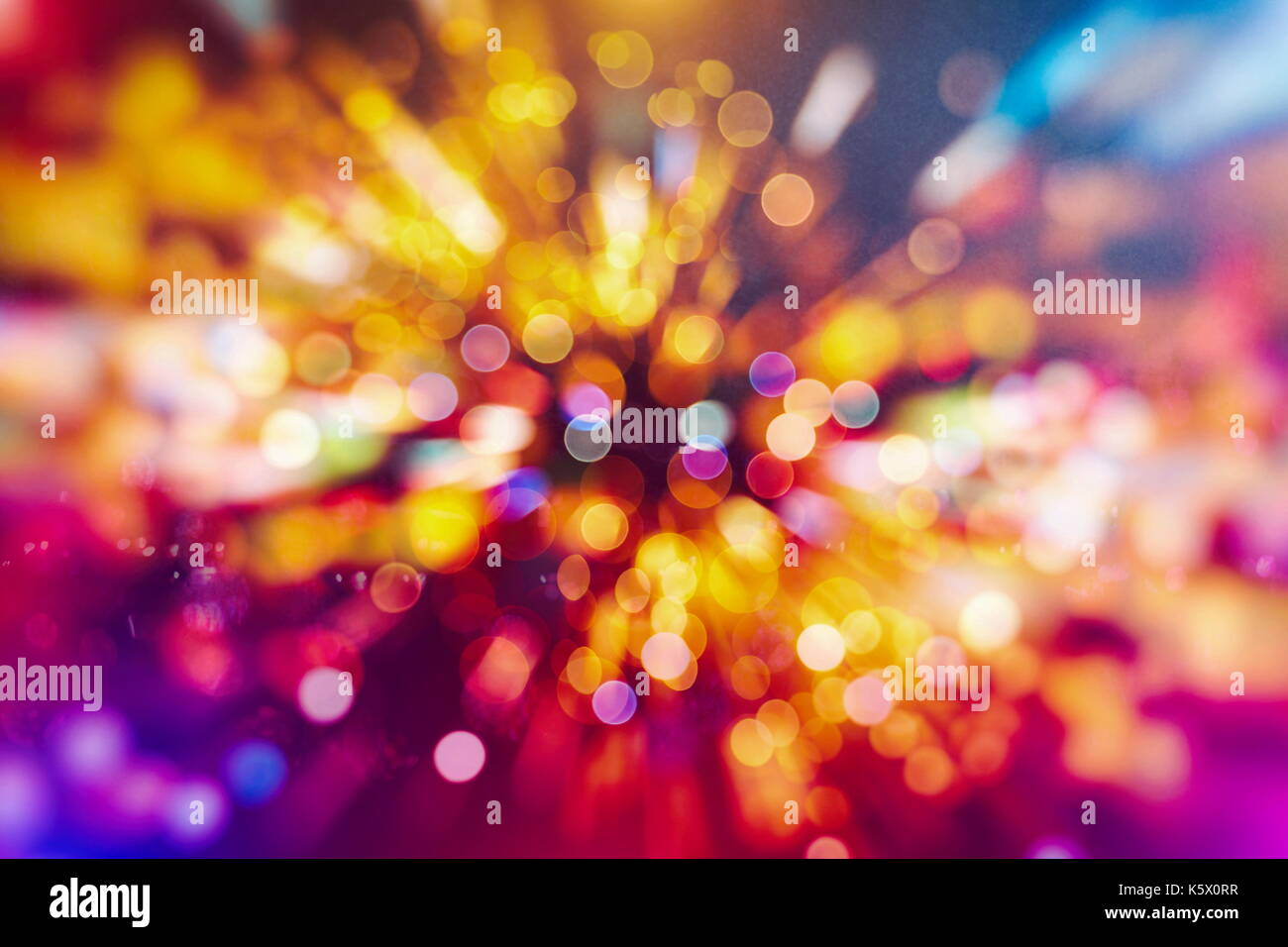 Festive background with natural bokeh and bright golden lights. Vintage Magic background with colorful bokeh. Spring Stock Photo