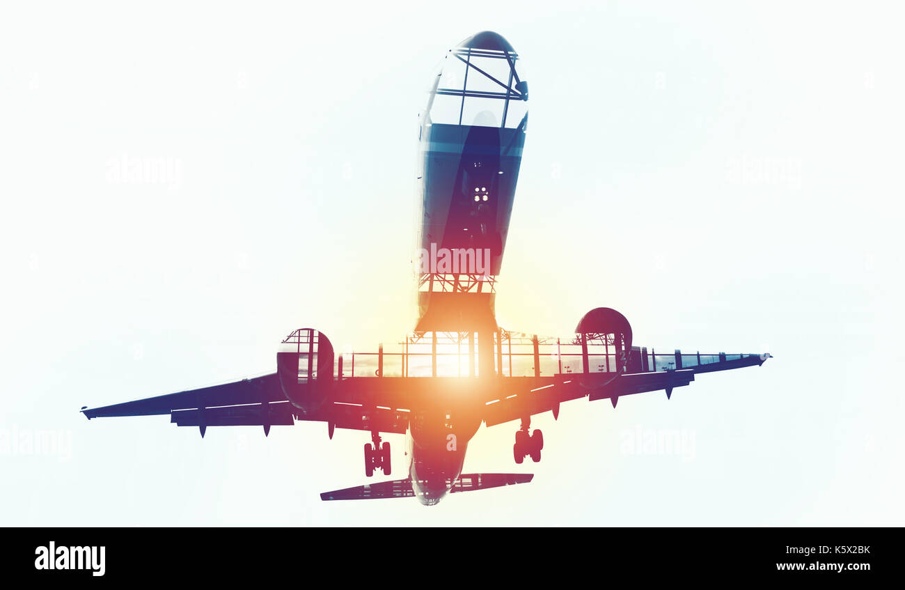 Take off of an aircraft with double exposure of airport - Stock Image