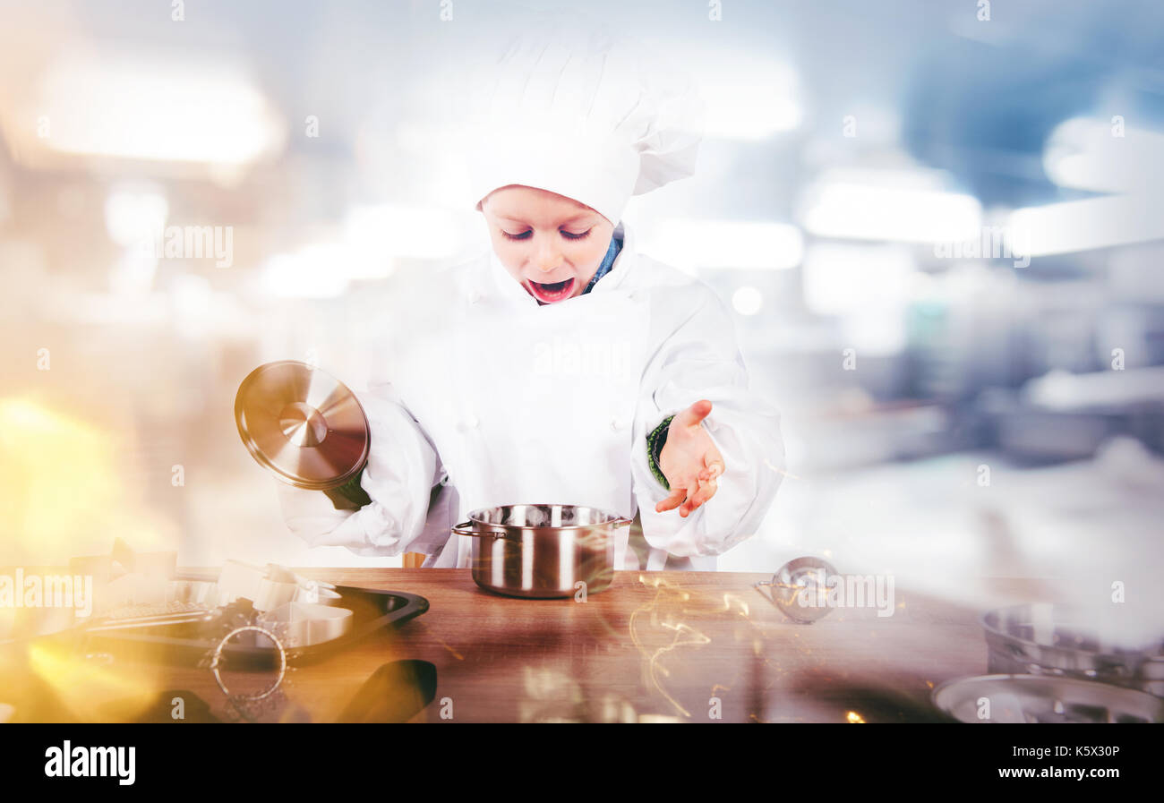 Young chef invents in the kitchen - Stock Image