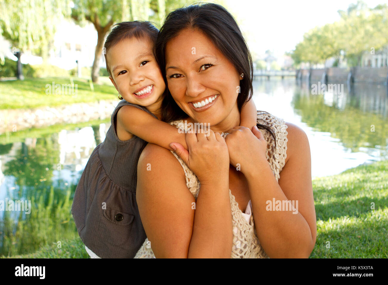 Asian mother and her child. - Stock Image