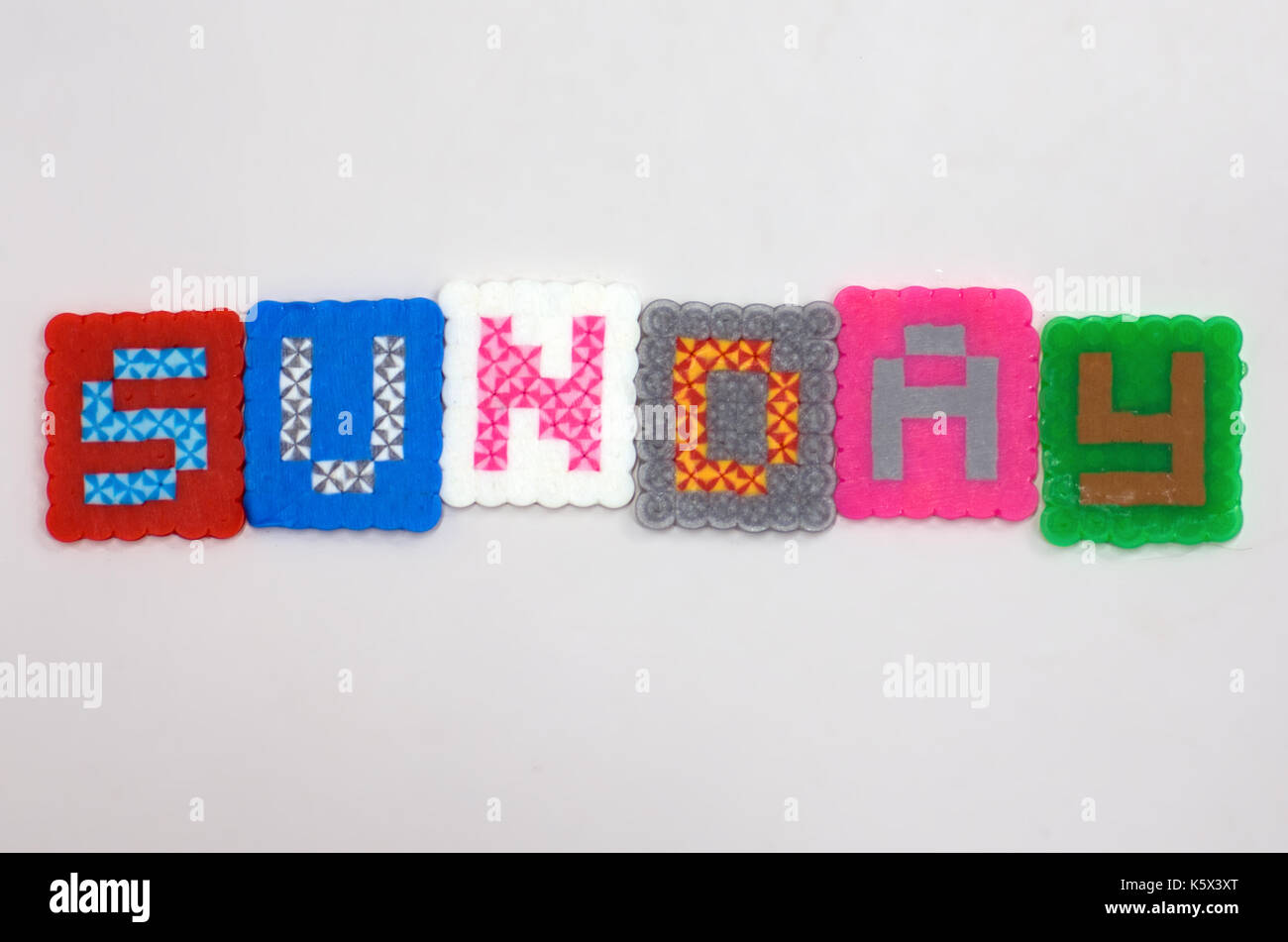 Fused bead word Sunday - Stock Image