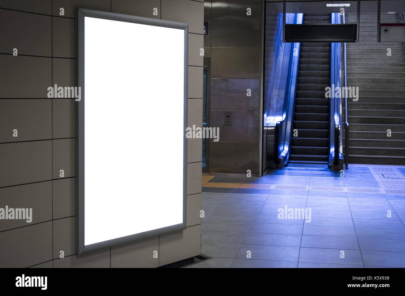 Empty billboard with escalator background - Stock Image