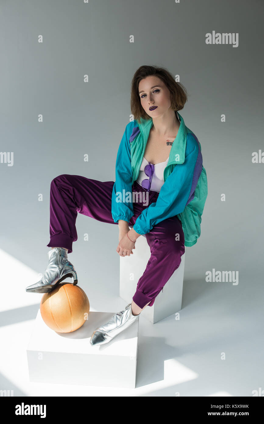 7cbf0d73cfbb girl in sport suit and high heels Stock Photo  158545119 - Alamy