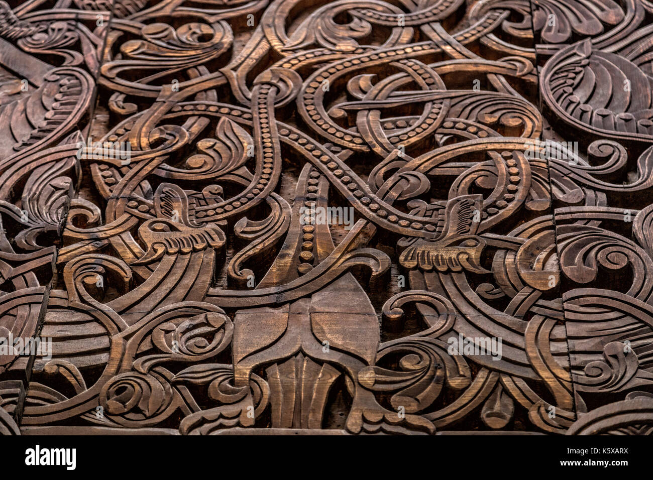Close-up of woodcarvings of the Stave church portal in the NORSK FOLKEMUSEUM-  an open air Museum of Norwegian Cultural History, Oslo, Bygdøy, Norway. - Stock Image