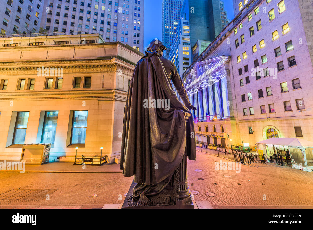 New York City, USA on Wall Street from Federal Hall in Lower Manhattan. Stock Photo