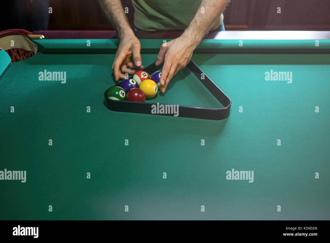 referee preparing the billiard balls on pool table - Stock Image