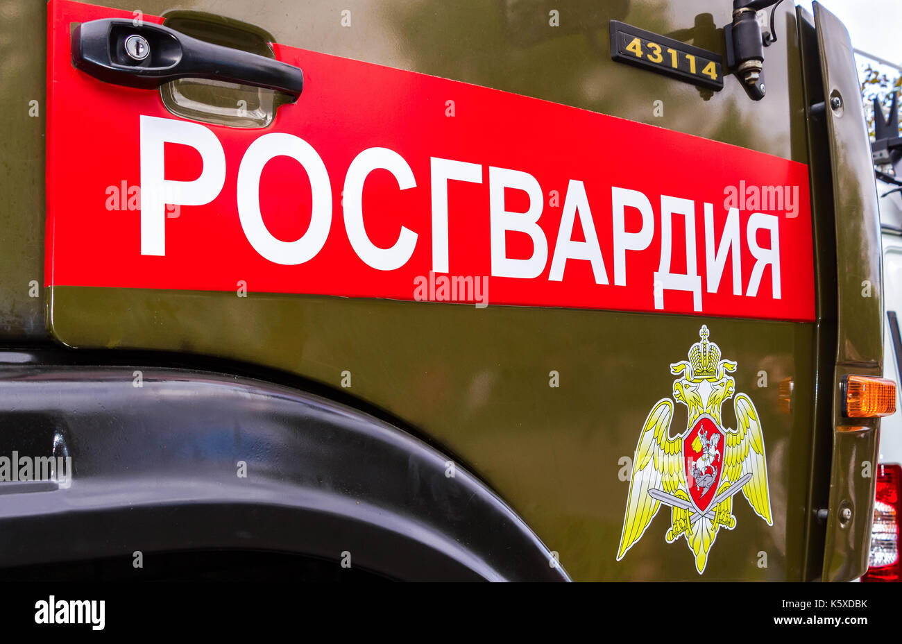 Samara, Russia - September 10, 2017: Inscription 'Rosgvardia' and emblem of the troops of the National Guard of the Russian Federation on the board of - Stock Image