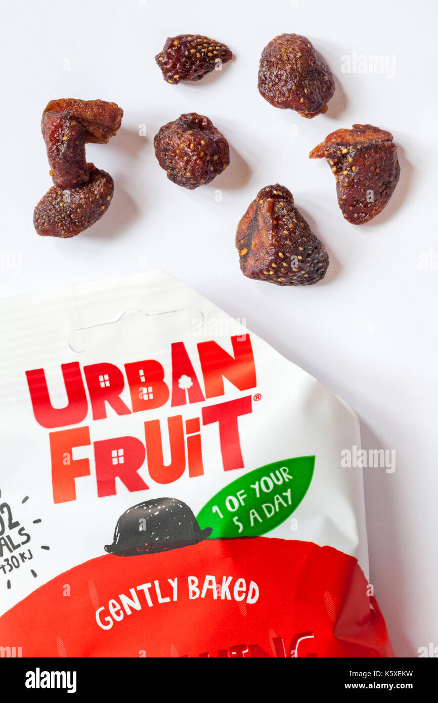 Packet of Urban Fruit gently baked smashing strawberry no added sugar 1 of your 5 a day opened with contents spilled - Stock Image