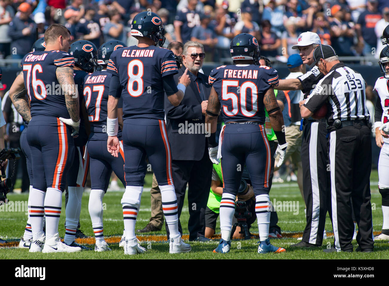 Chicago, Illinois, USA. 10th Sep, 2017. - Former Chicago Bears Head Coach Mike Ditka (center) during the coin flip before the NFL Game between the Atlanta Falcons and Chicago Bears at Soldier Field in Chicago, IL. Credit: csm/Alamy Live News - Stock Image