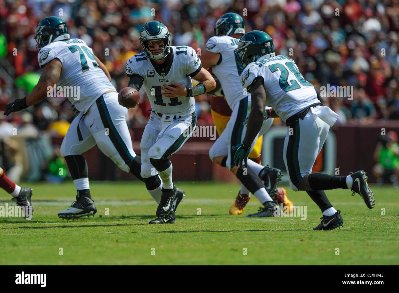 Landover, MD, USA. 10th Sep, 2017. Philadelphia Eagles quarterback Carson Wentz (11) hands off to Philadelphia Eagles running back Wendell Smallwood (28) during the season opening matchup between the Philadelphia Eagles and the Washington Redskins at FedEx Field in Landover, MD. Credit: csm/Alamy Live News - Stock Image