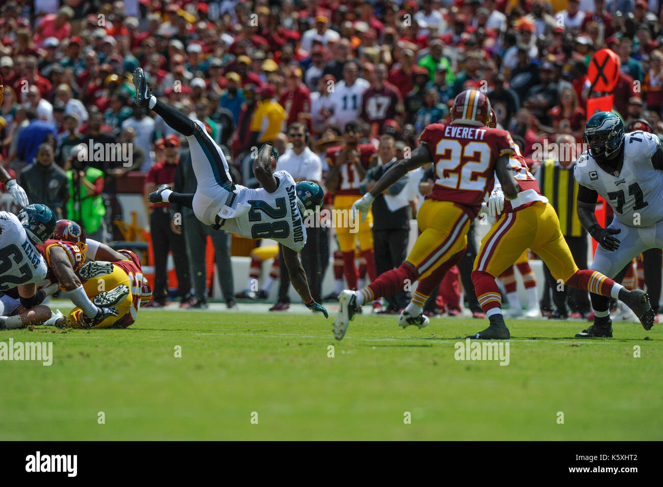 Landover, MD, USA. 10th Sep, 2017. Philadelphia Eagles running back Wendell Smallwood (28) gets up ended by the defenders during the season opening matchup between the Philadelphia Eagles and the Washington Redskins at FedEx Field in Landover, MD. Credit: csm/Alamy Live News - Stock Image