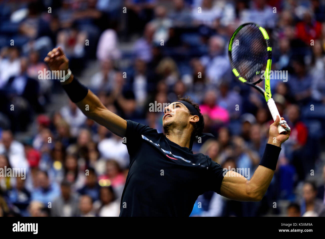 New York, United States. 10th Sep, 2017. US Open Tennis: New York, 10 September, 2017 - Rafael Nadal of Spain serving - Stock Image
