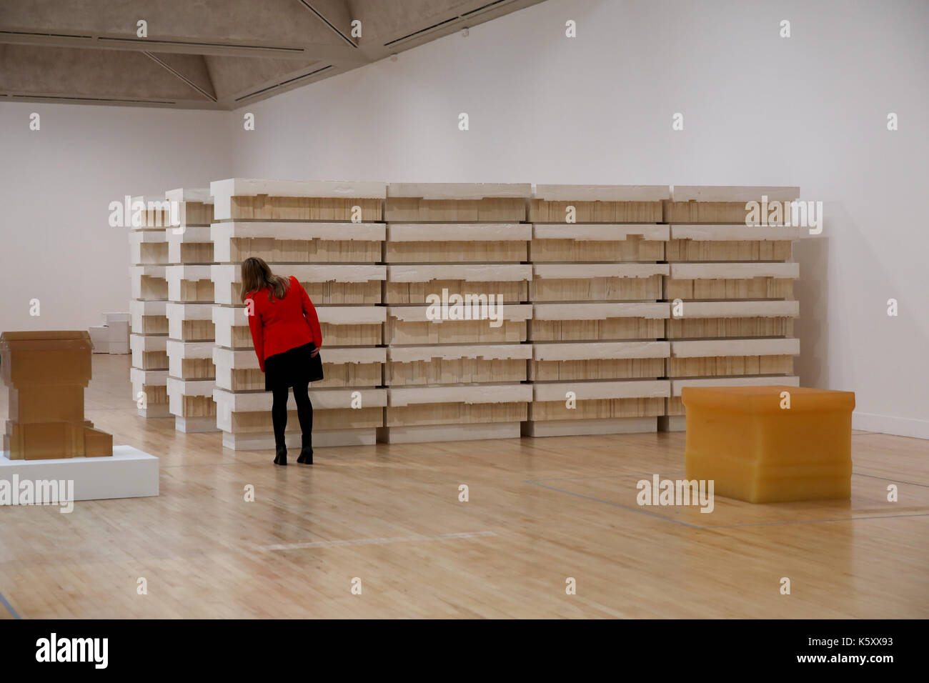 London, UK. 11th Sept, 2017. A member of staff looks at 'Untitled (Book Corridors). One of the leading artists of Stock Photo
