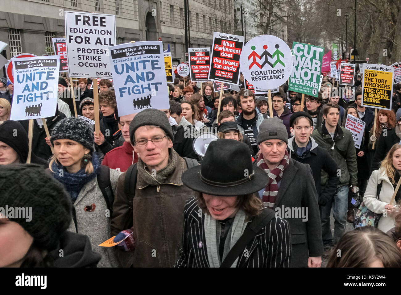 Students protest in central London against public spending cuts and the rise in tuition fees. - Stock Image