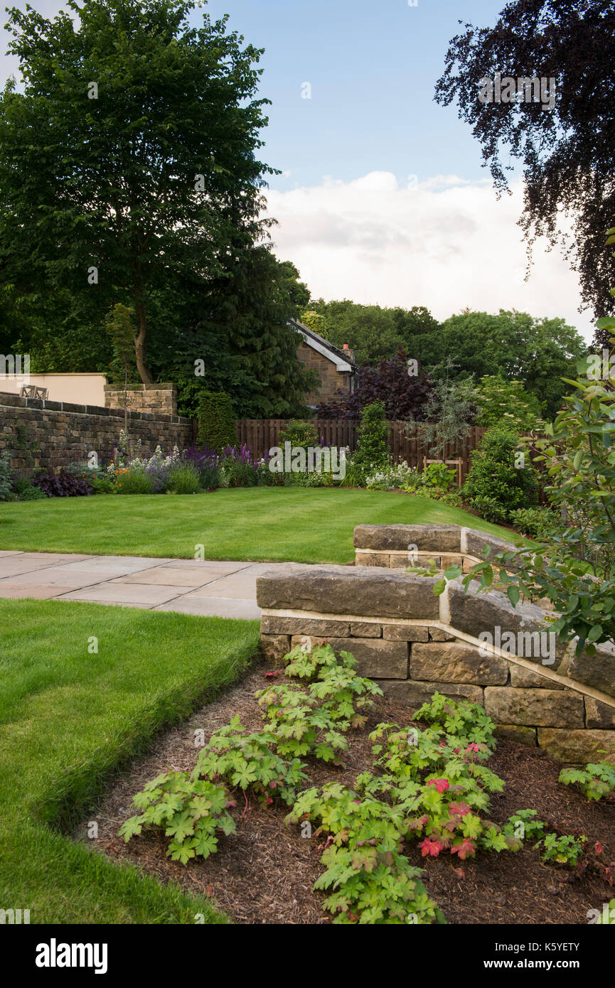 Beautiful, private, traditional, landscaped, country garden, West Yorkshire, England, UK - herbaceous borders, summer Stock Photo