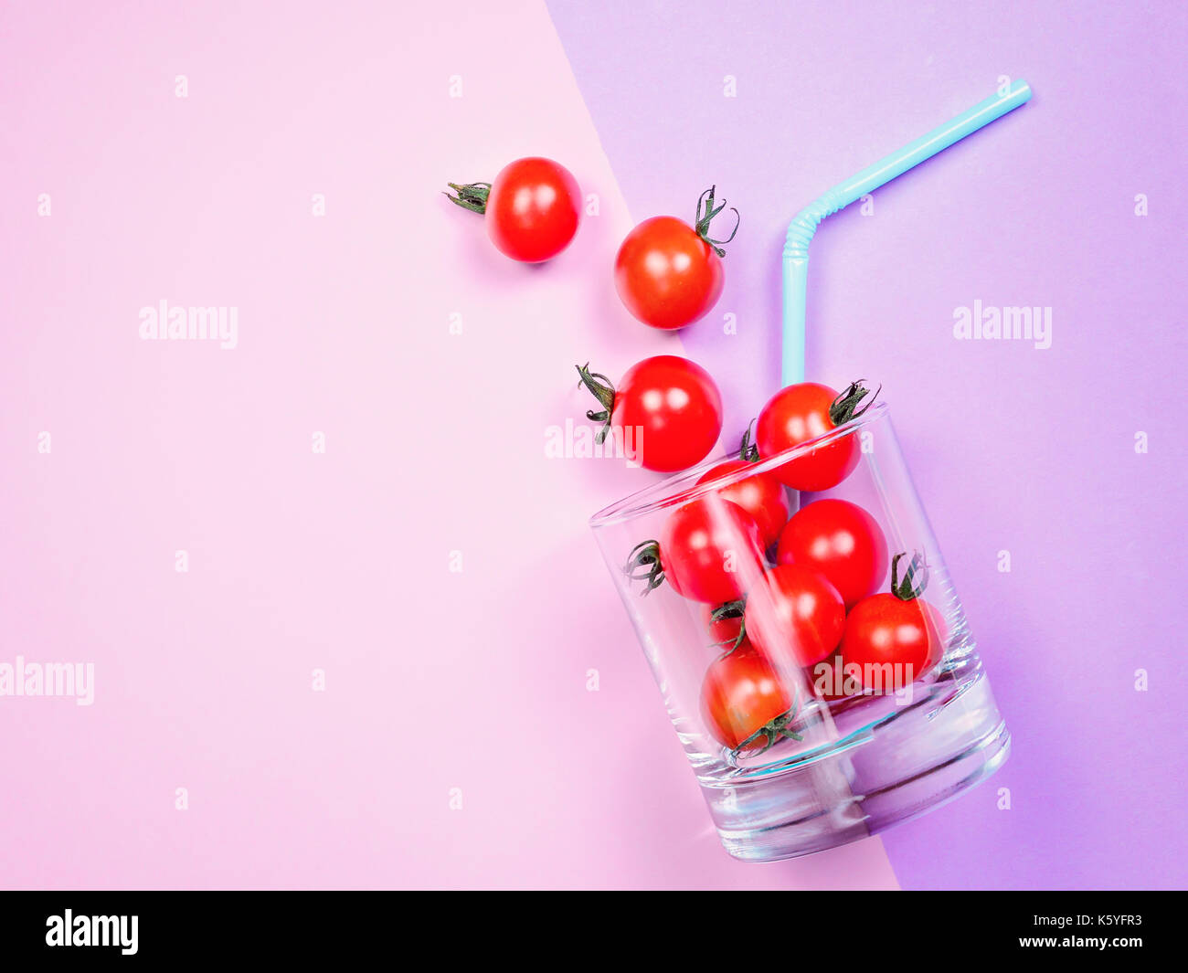 Tomato juice or smoothie, cherry tomato in drink glass with straw Stock Photo