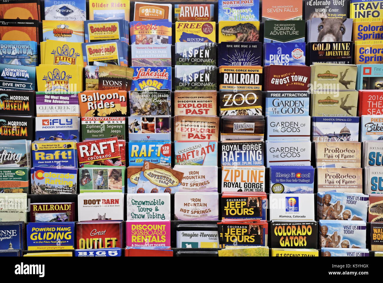 Colorful Colorado Tourist Brochures arranged in a rack - Stock Image