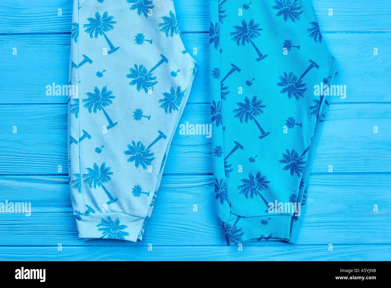 5f0465e54594 Top quality baby summer pants. Close up of organic baby printed leggings on  blue wooden
