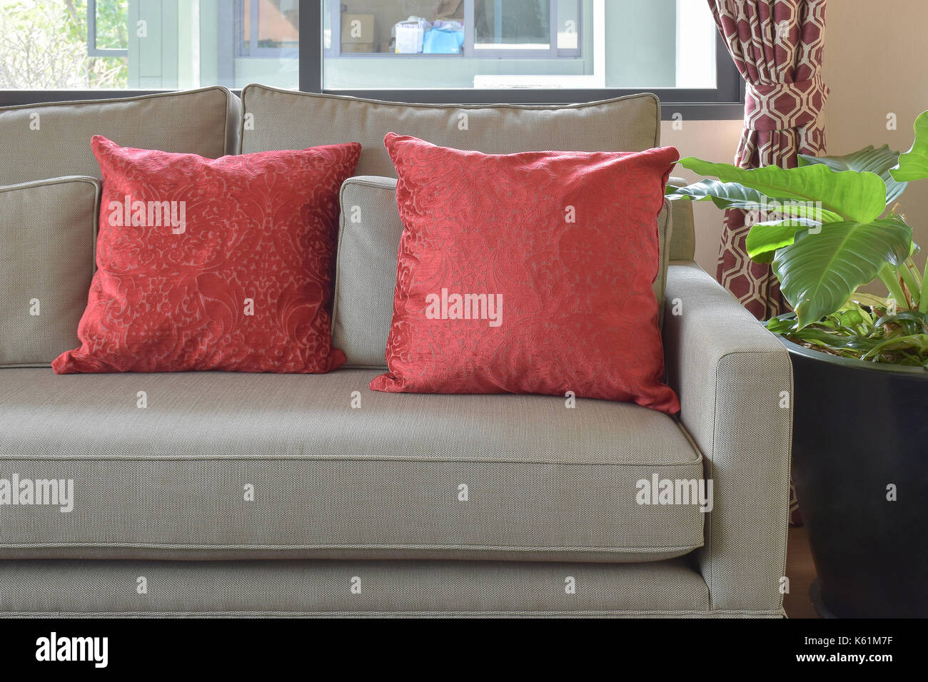 Enjoyable Red Pillows On Brown Sofa In Living Area At Home Stock Photo Andrewgaddart Wooden Chair Designs For Living Room Andrewgaddartcom