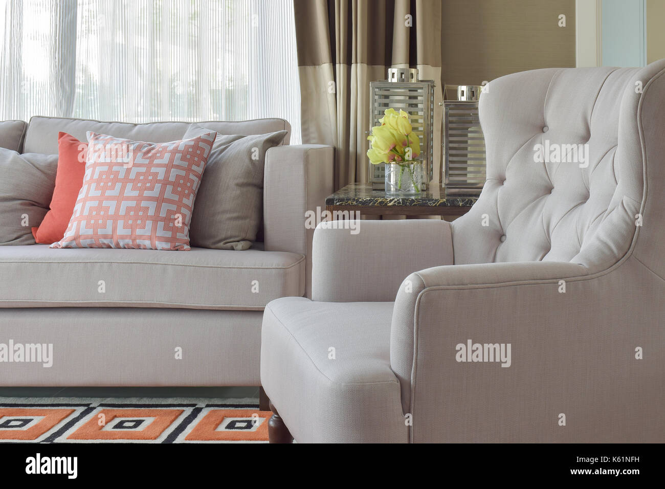 Comfy beige arm char with chinese style in orange theme living corner - Stock Image