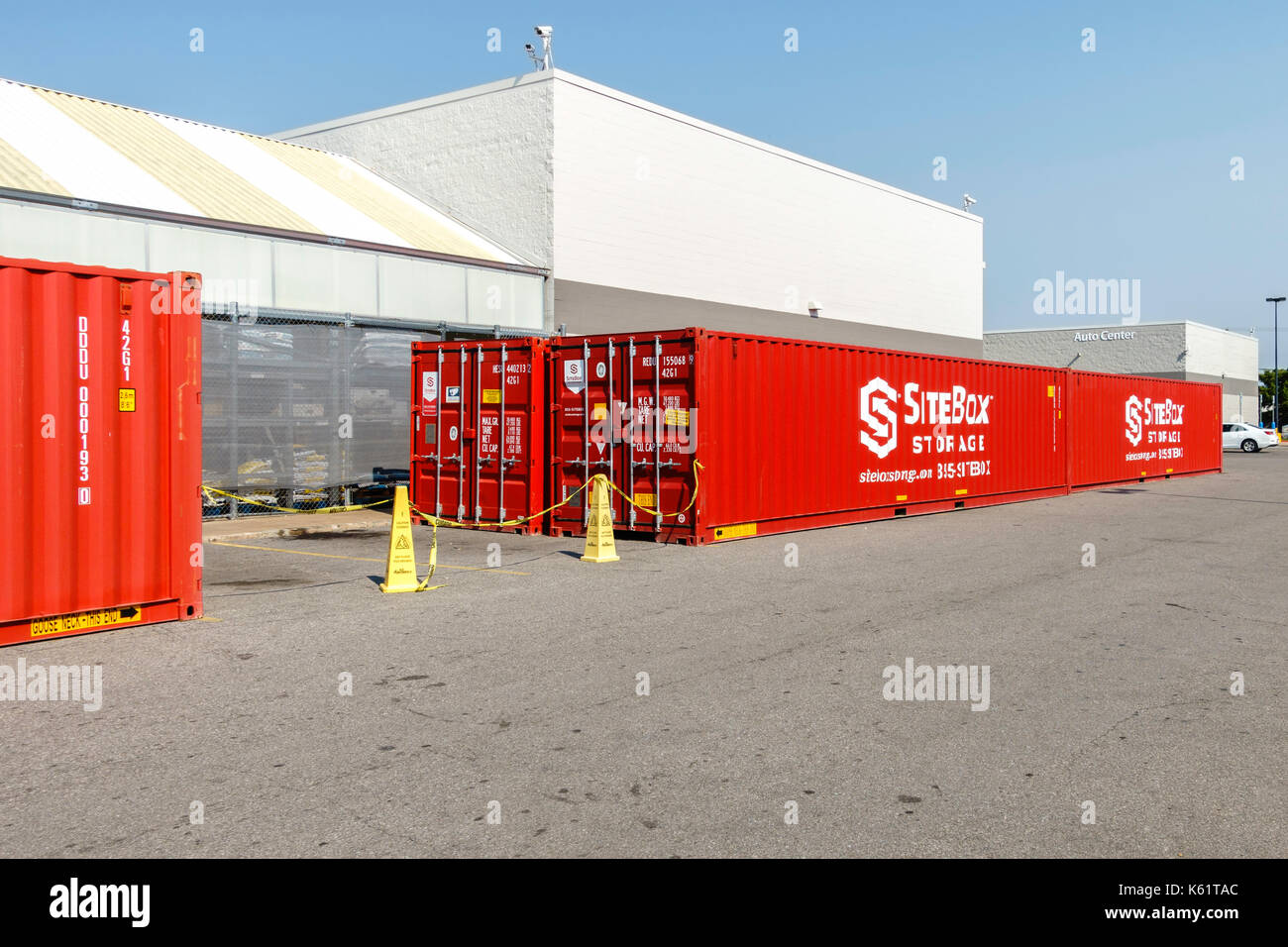 Red ed metal portable SiteBox storage containers in a Walmart