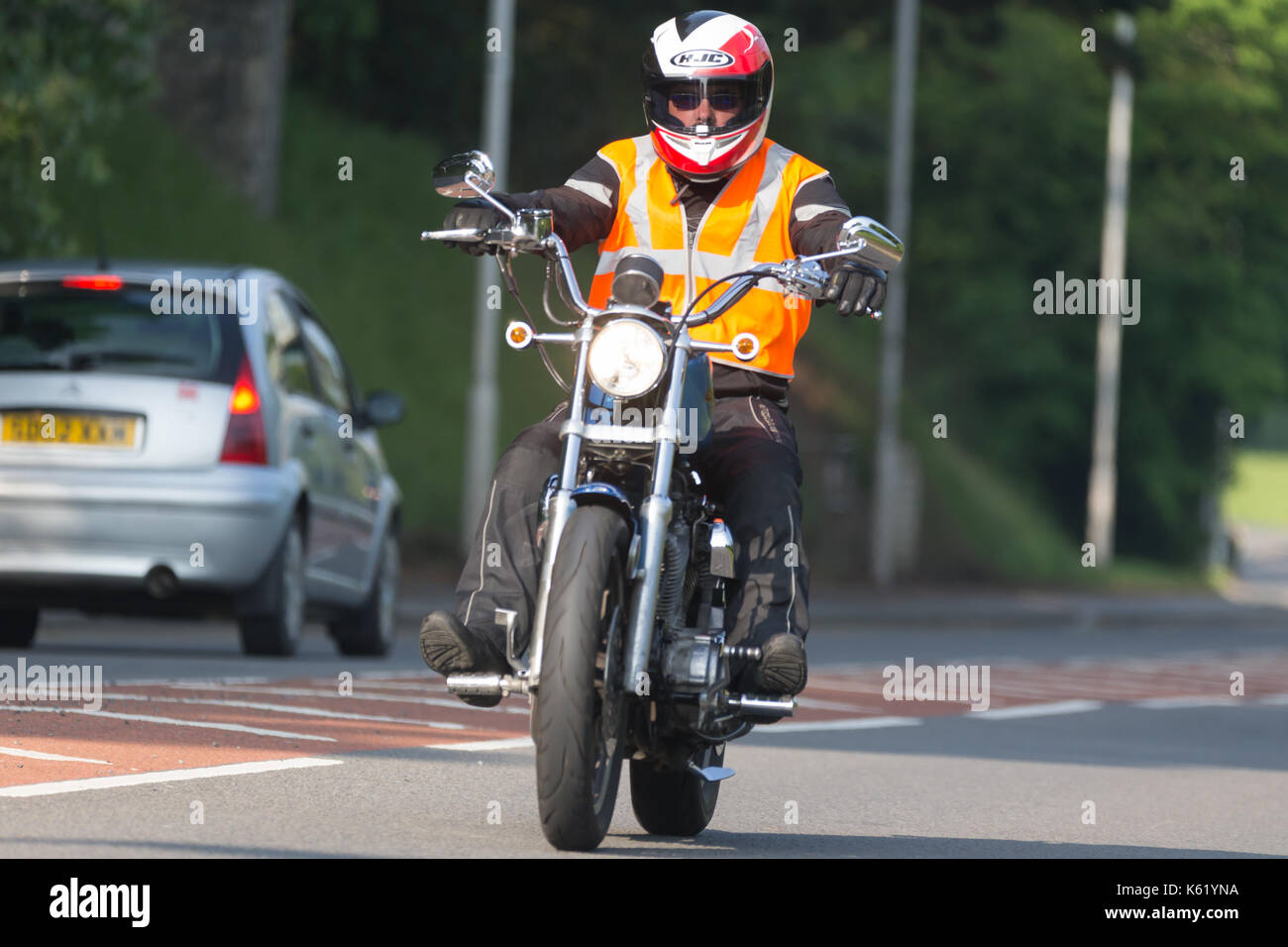 motorcyclists riding his motorbike along the road Stock Photo