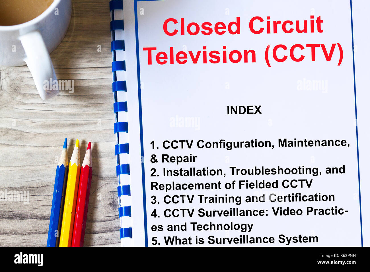 CCTV surveillance security camera concept- with topics on a cover sheet of aa lecture Stock Photo