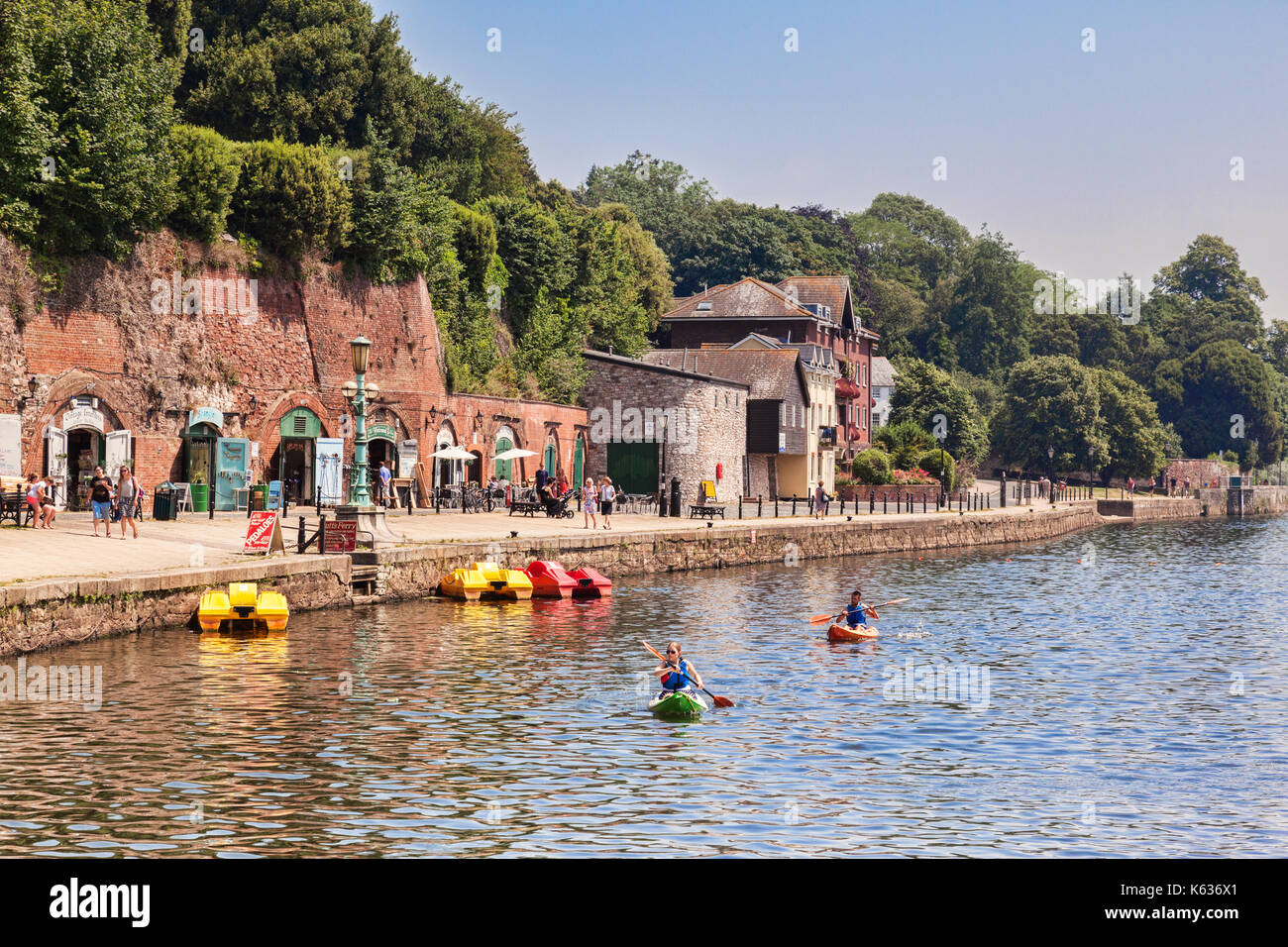 21 June 2017: Exeter, Devon, England, UK - The River Exe at Exeter Quay, with shops and people kayaking on the river. - Stock Image
