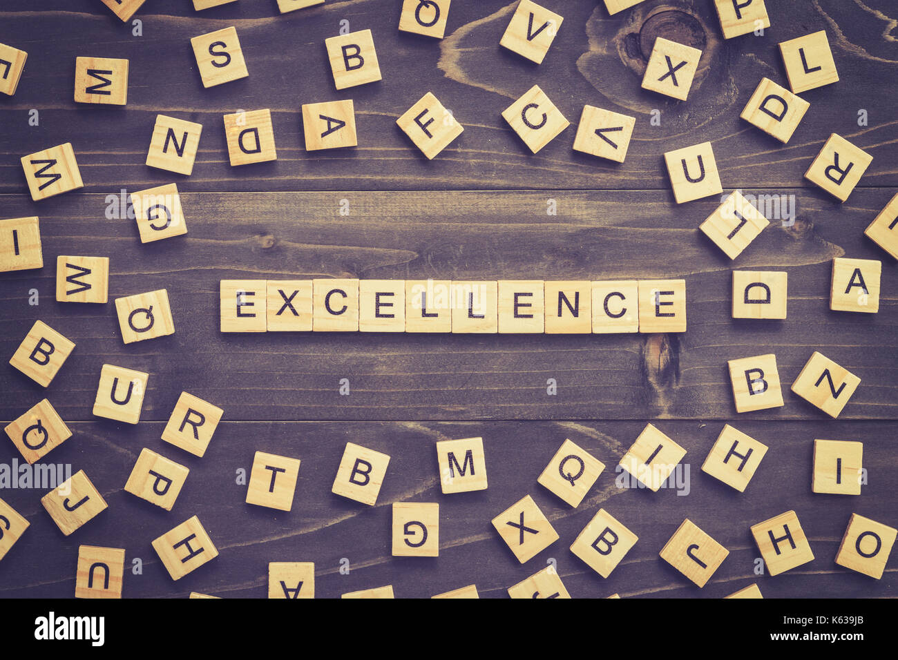 Excellence word wood block on table for business concept. - Stock Image