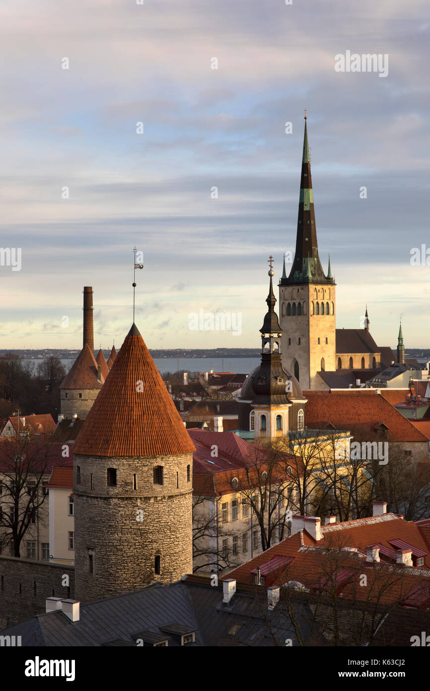 View over the Old Town with the towers of the City Walls and Oleviste Church from Patkuli Viewing Platform, Old Town, Tallinn, Estonia, Europe - Stock Image
