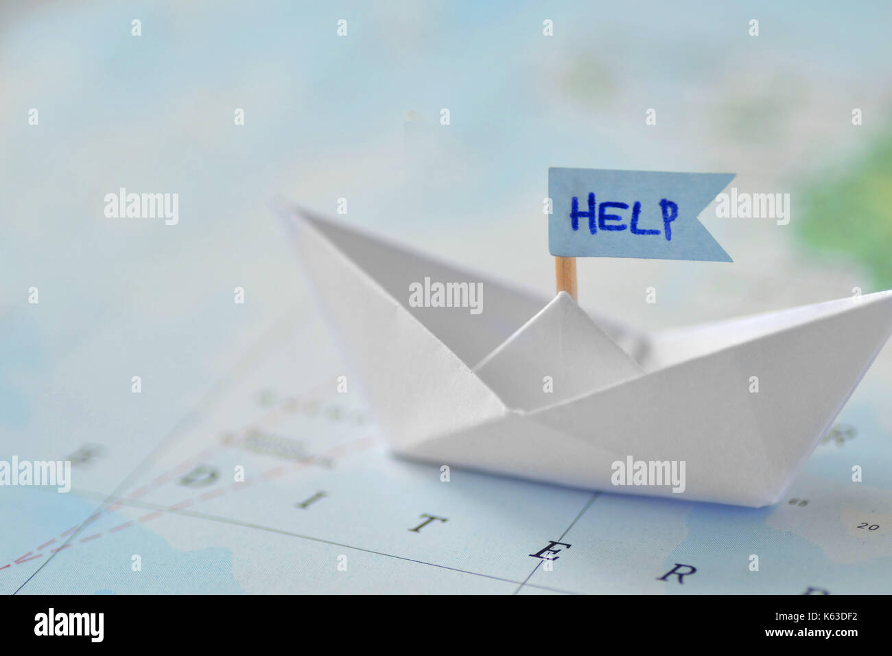 Immigration and ask for asylum concept - paper boat on a map - Stock Image