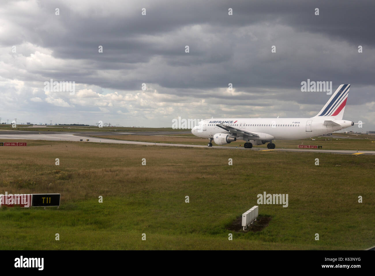 Air France Airbus A320, F-GKXA, taxying on to the runway for departure ate Paris Charles De Gaulle Airport. - Stock Image