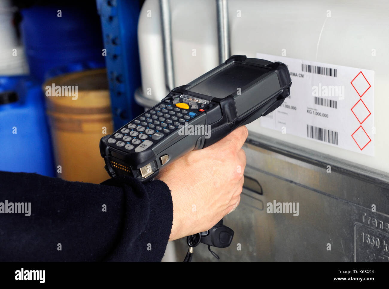 Human hand holding barcode scanner for scanning codes - Stock Image