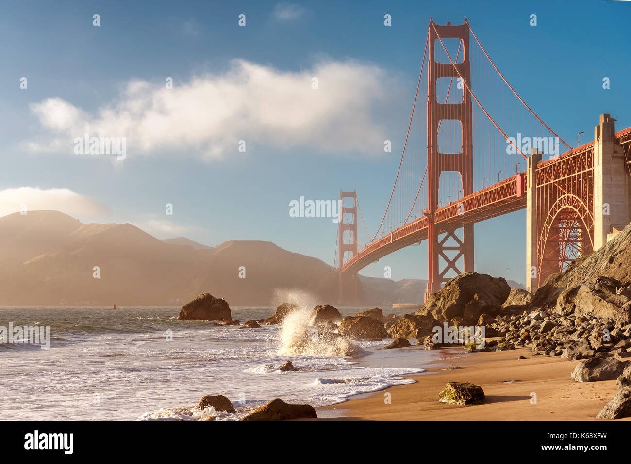 Golden Gate Bridge from the beach in San Francisco at sunset. - Stock Image