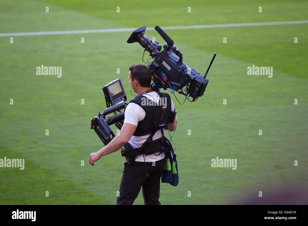 Television cameraman - 6/5/17 Barcelona v Villarreal football league match at the Camp Nou stadium, Barcelona. - Stock Image