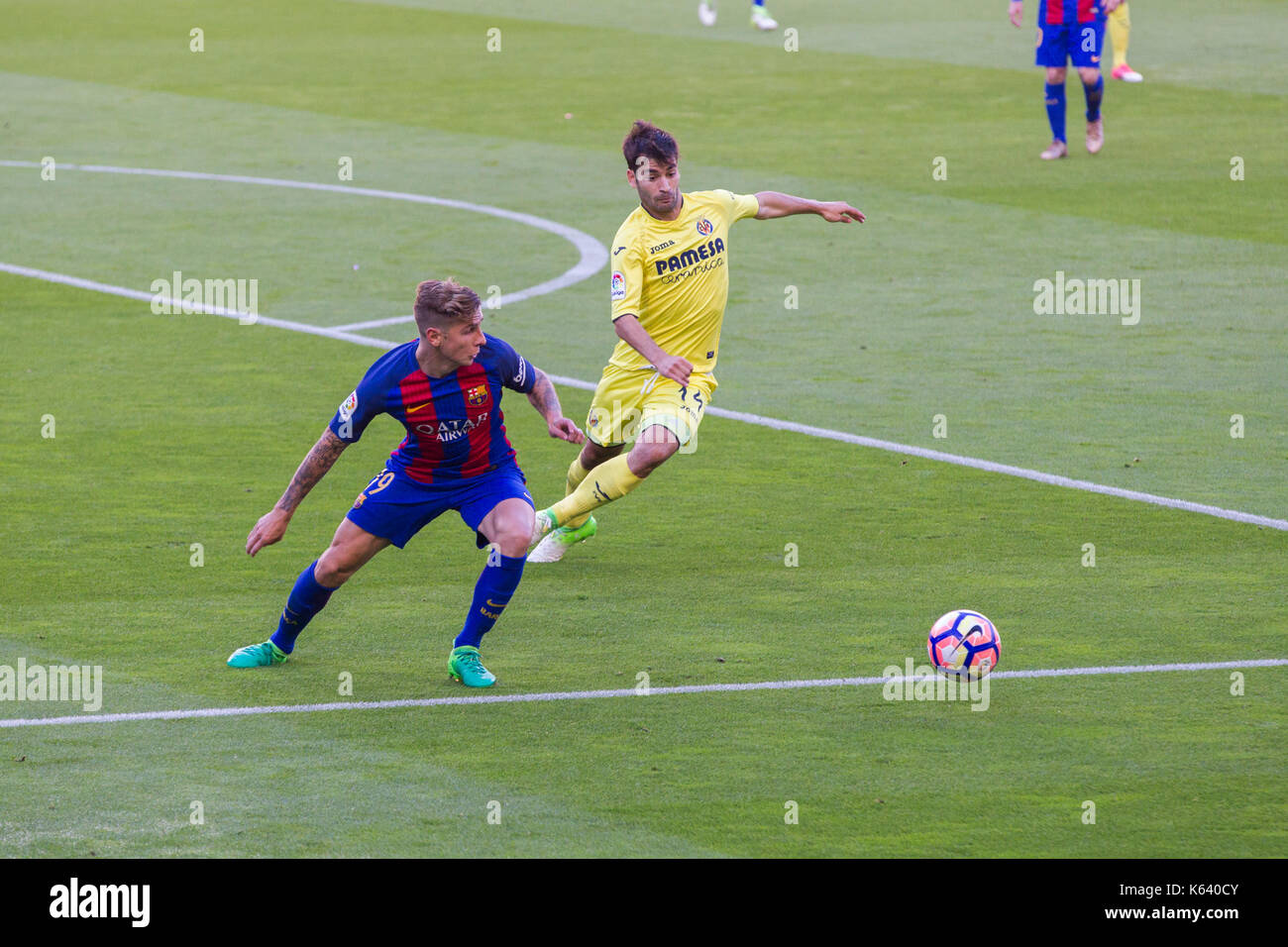 Lucas Digne competing for ball - 6/5/17 Barcelona v Villarreal football league match at the Camp Nou stadium, Barcelona. - Stock Image