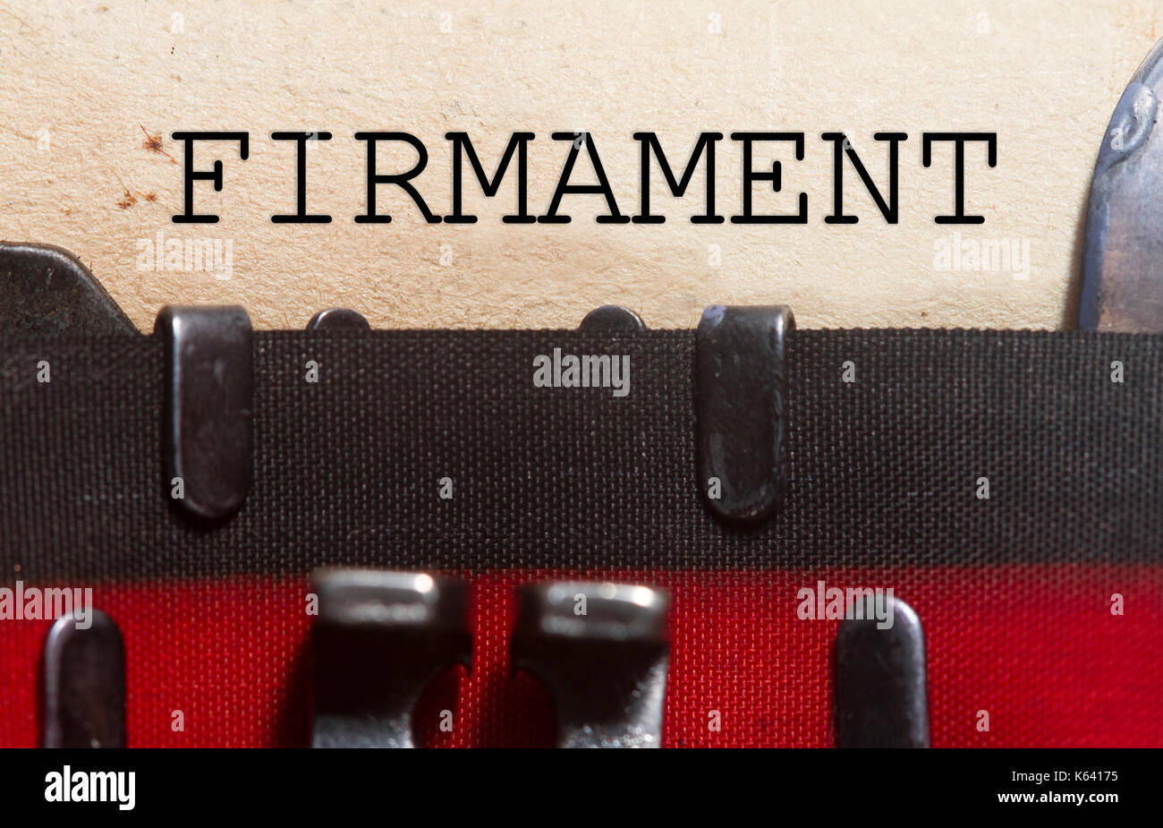 Firmament  typed on an old vintage paper with od typewriter font. - Stock Image