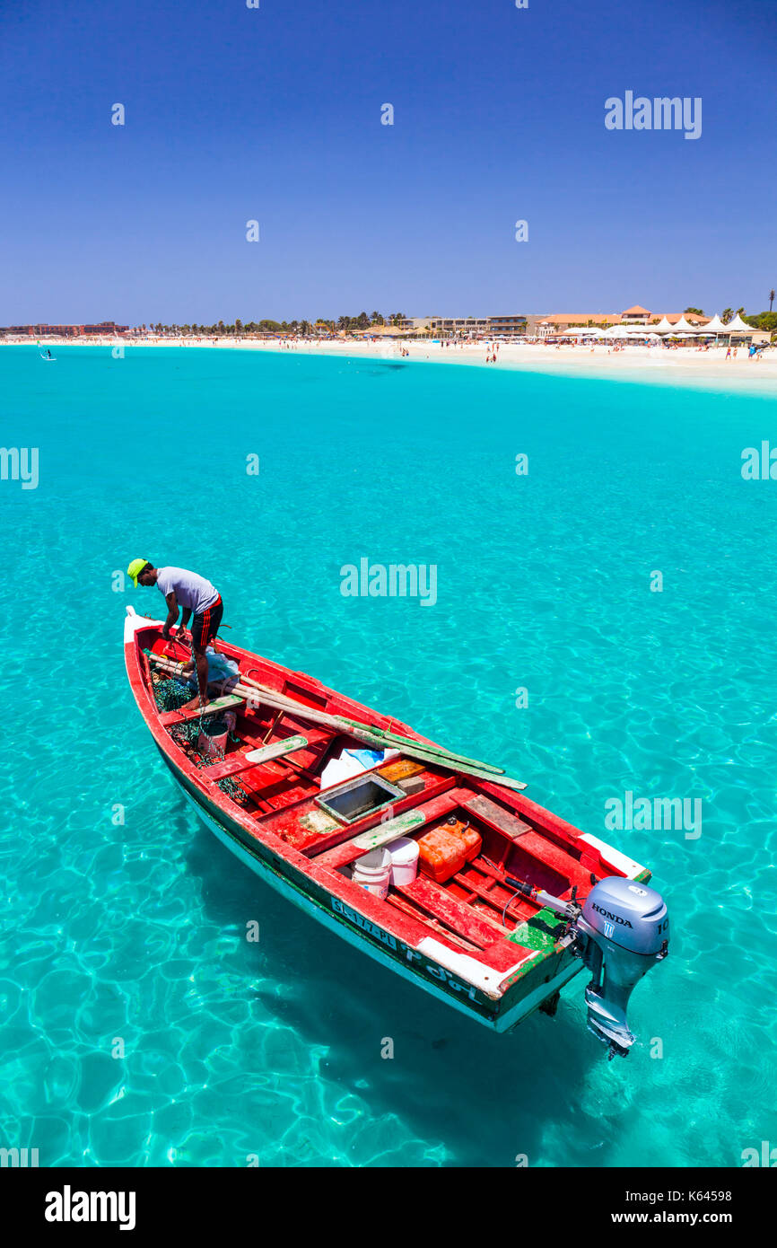 CAPE VERDE SAL Fisherman bringing his catch of fish in a decorated fishing boat to the pier at Santa Maria, Sal - Stock Image