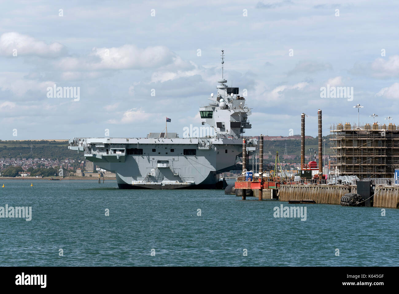 Portsmouth England UK.Royal Navy Dockyard with aircraft carrier HMS Queen Elizabeth alongside the Princess Royal jetty. August 2017. - Stock Image