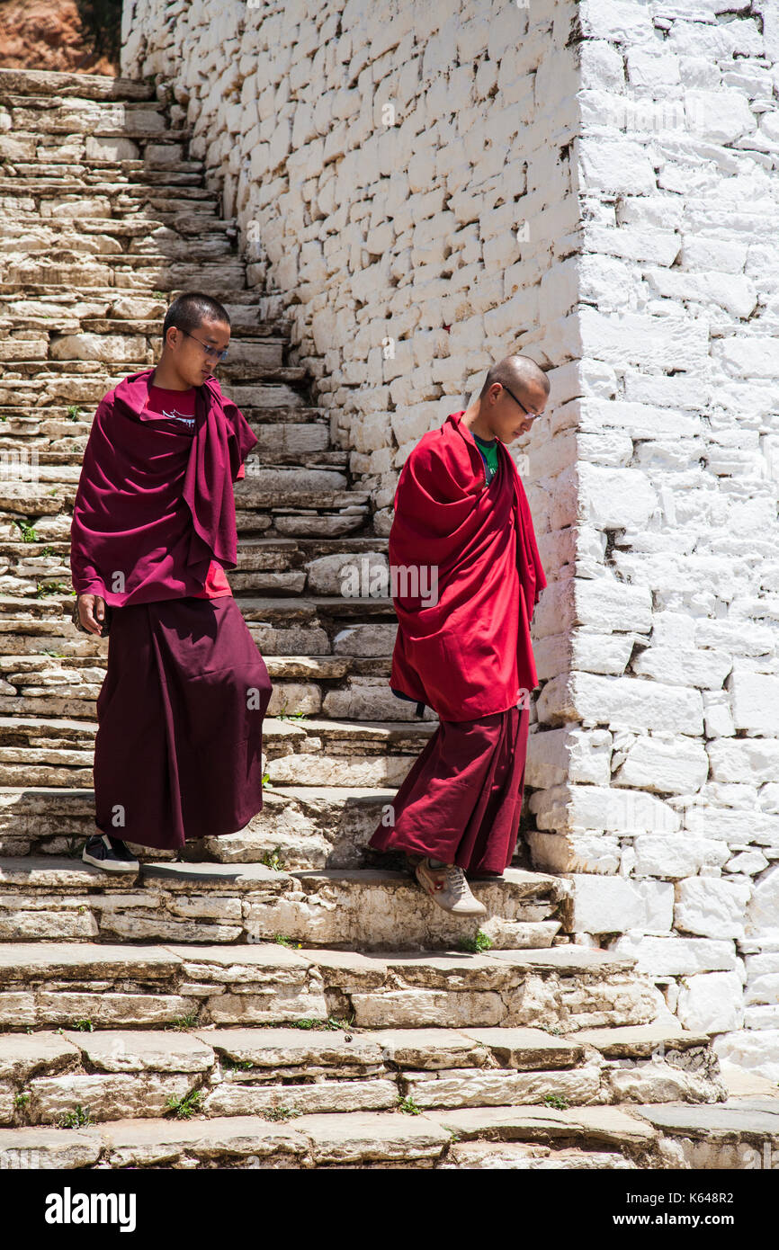 Buddhist monks at holy temple, Bhutan - Stock Image