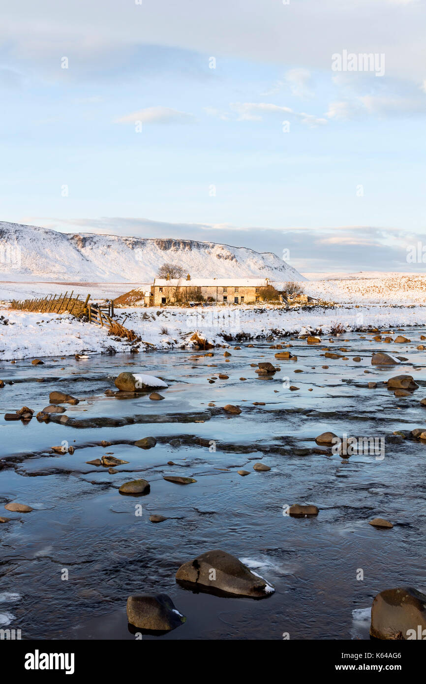 The Abandoned Farmstead of Wheysike House Across Harwood Beck with Cronkley Fell Behind, Forest-in-Teesdale, County Durham UK - Stock Image