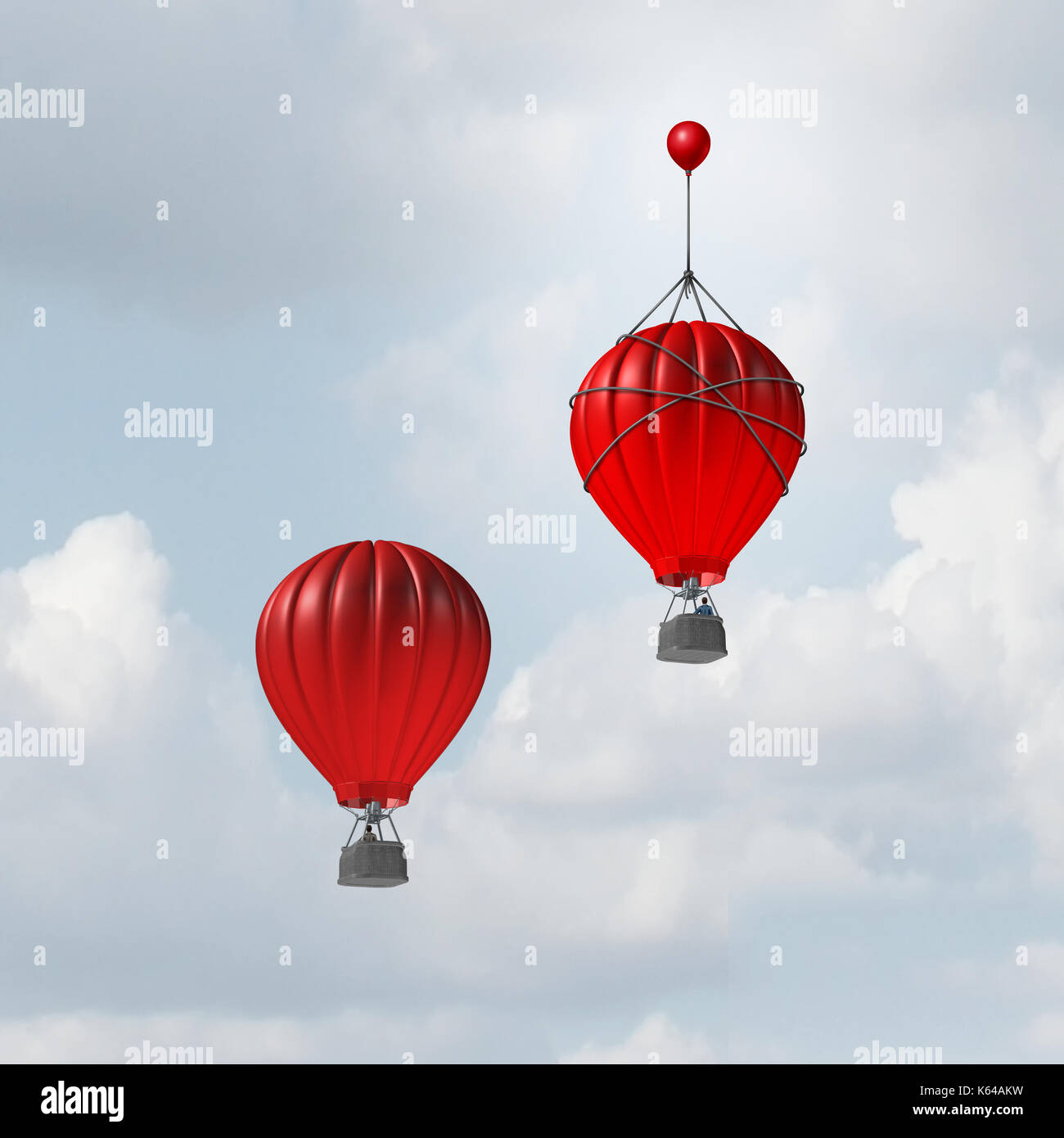Concept of advantage and competitive edge as two hot air balloons racing to the top but a leader with a small balloon attached giving the winning. - Stock Image