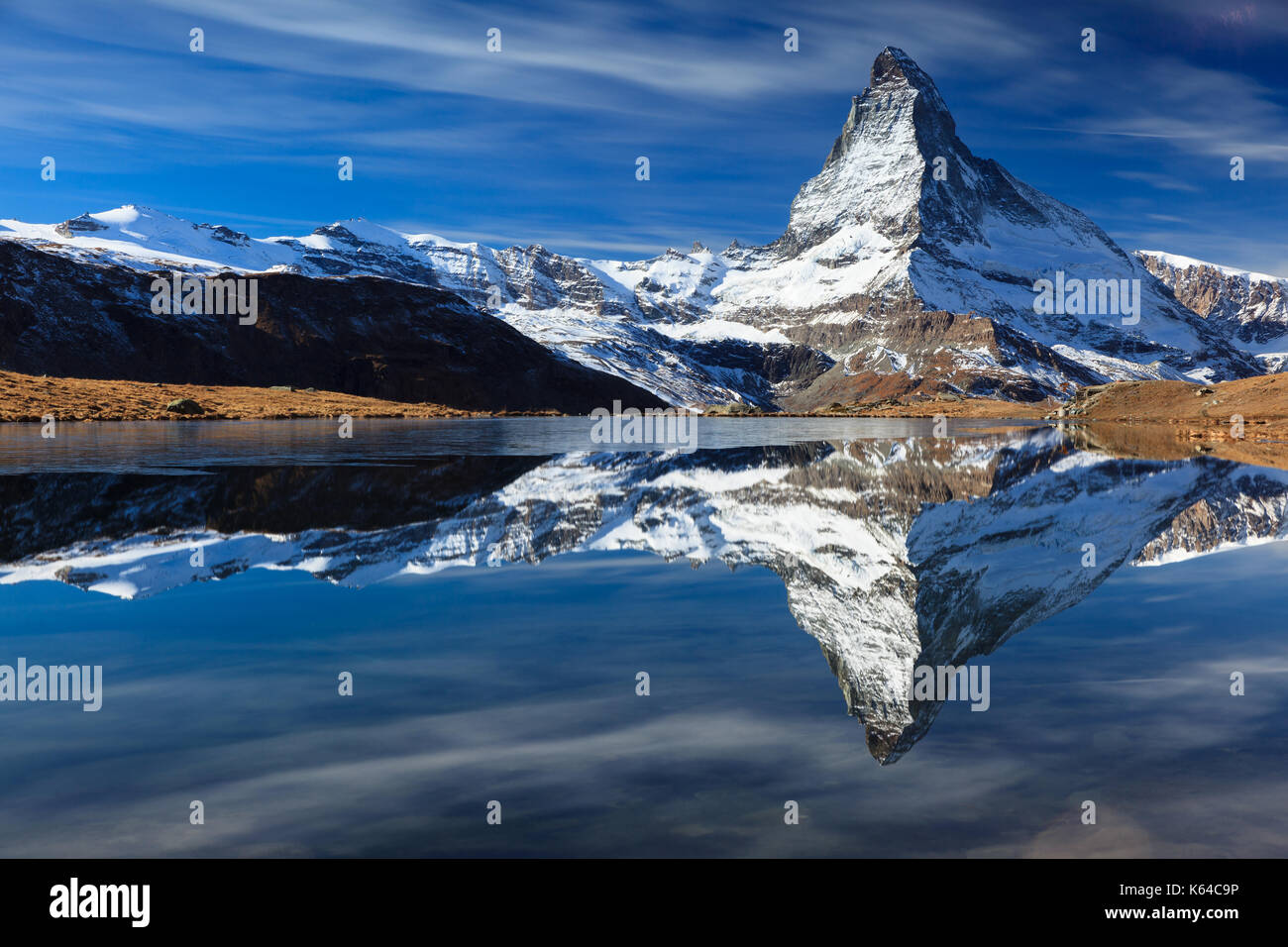 Matterhorn with snow reflected in the lake, Valais, Switzerland - Stock Image