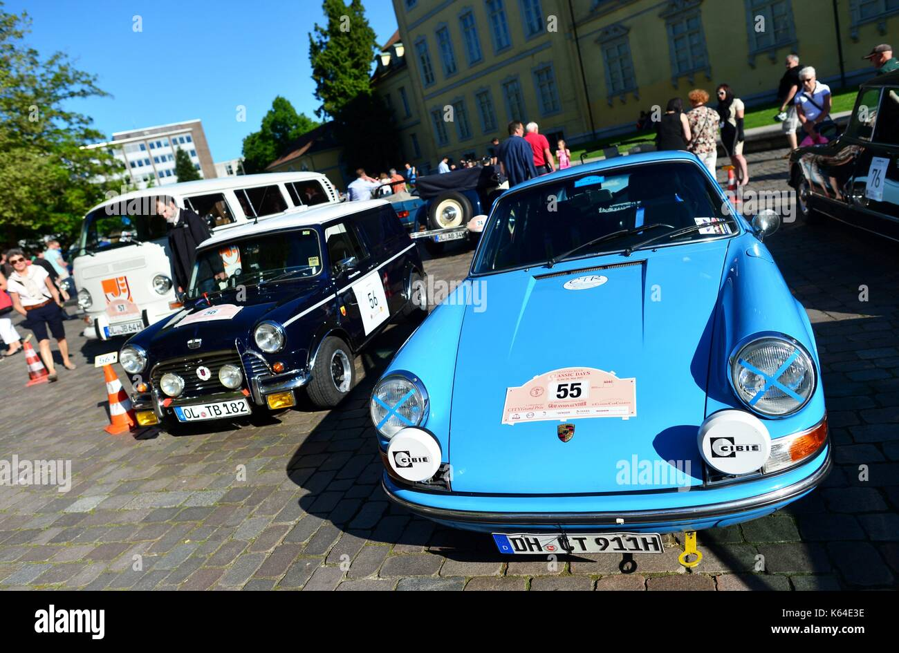 Oldtimers of the type Porsche 911 (l) and British Leyland Mini Van Mark II (r) at the City Grand Prix in Oldenburg Stock Photo