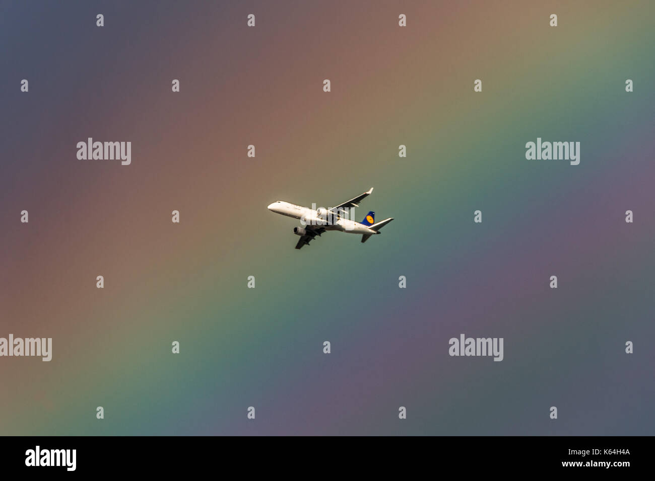London, UK. 11th Sep, 2017. UK Weather: A German Lufthansa passenger jet leaving City Airport passes through a massive colourful rainbow over the city. Credit: Guy Corbishley/Alamy Live News - Stock Image