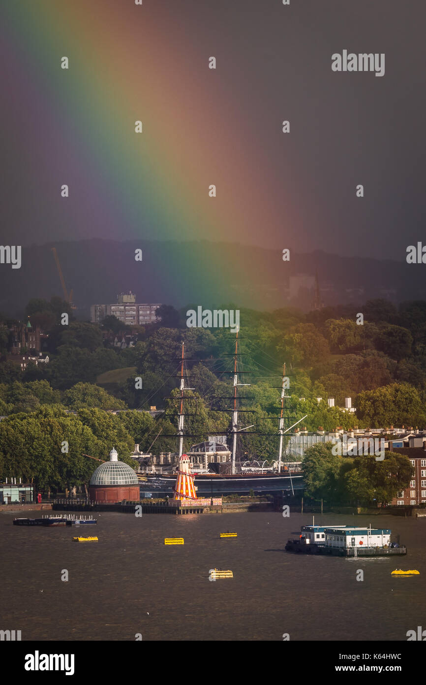London, UK. 11th Sep, 2017. UK Weather: Cutty Sark ship seen in Greenwich during a breaking colourful rainbow over south east London. Credit: Guy Corbishley/Alamy Live News - Stock Image