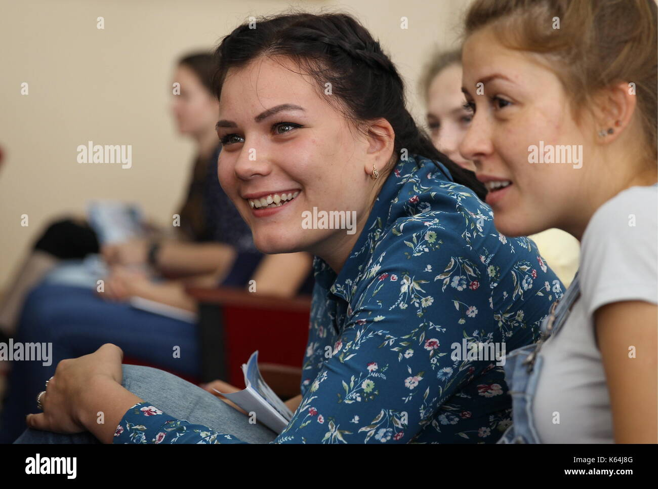 KRASNODAR, RUSSIA - SEPTEMBER 11, 2017: Young women attend a meeting with admissions office members as the Krasnodar Aviation Military High School starts education of female pilots. Vitaly Timkiv/TASS - Stock Image