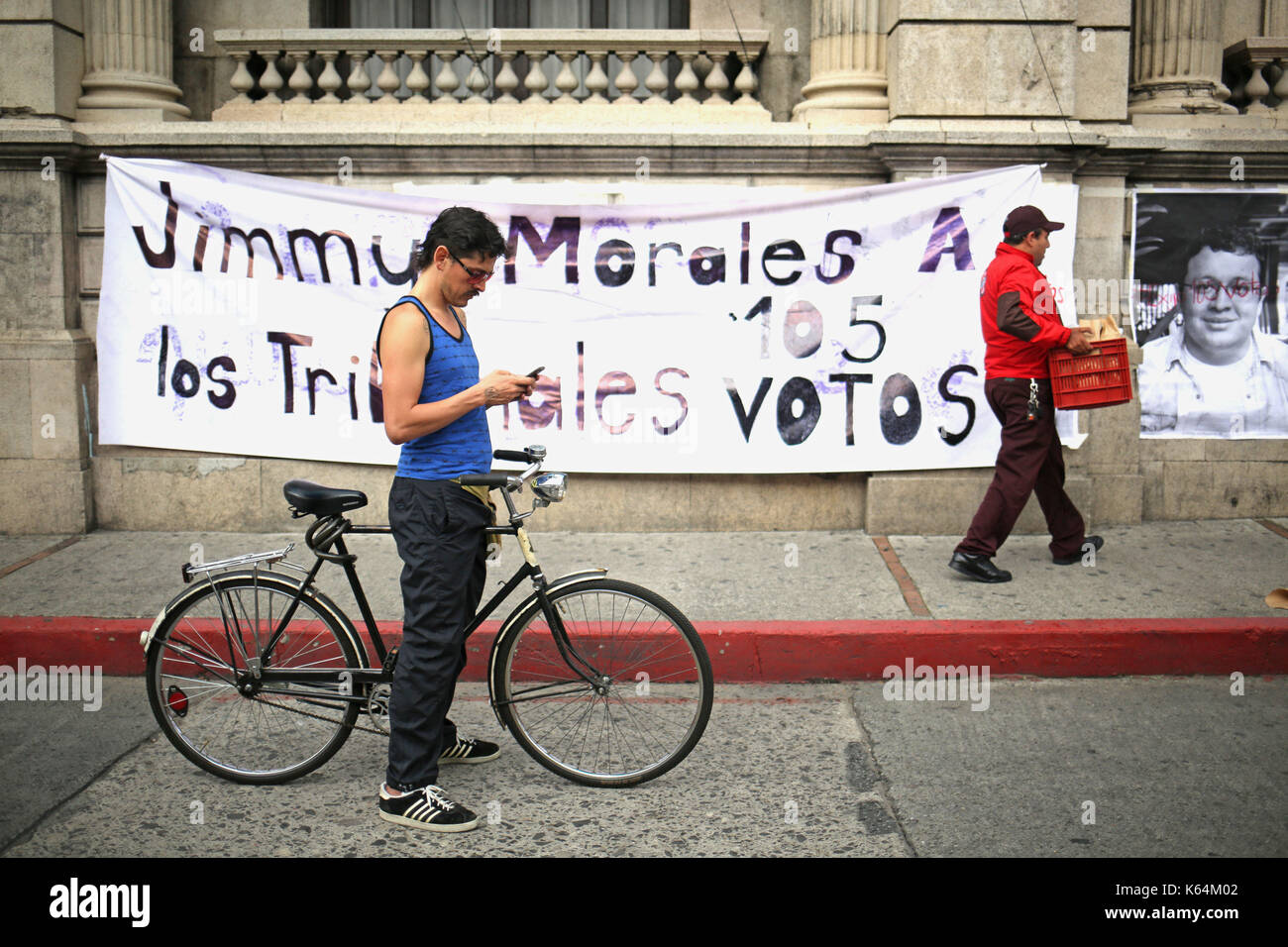 A group of protestors demand that deputies remove the privilege of Guatemalan President Jimmy Morales, as recommended - Stock Image